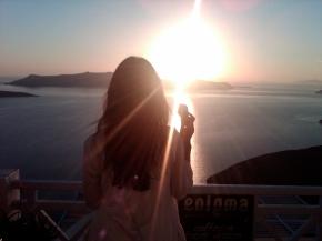 Wifey of a Roadie on Santorini Island enjoying some ice cream and the sunset.